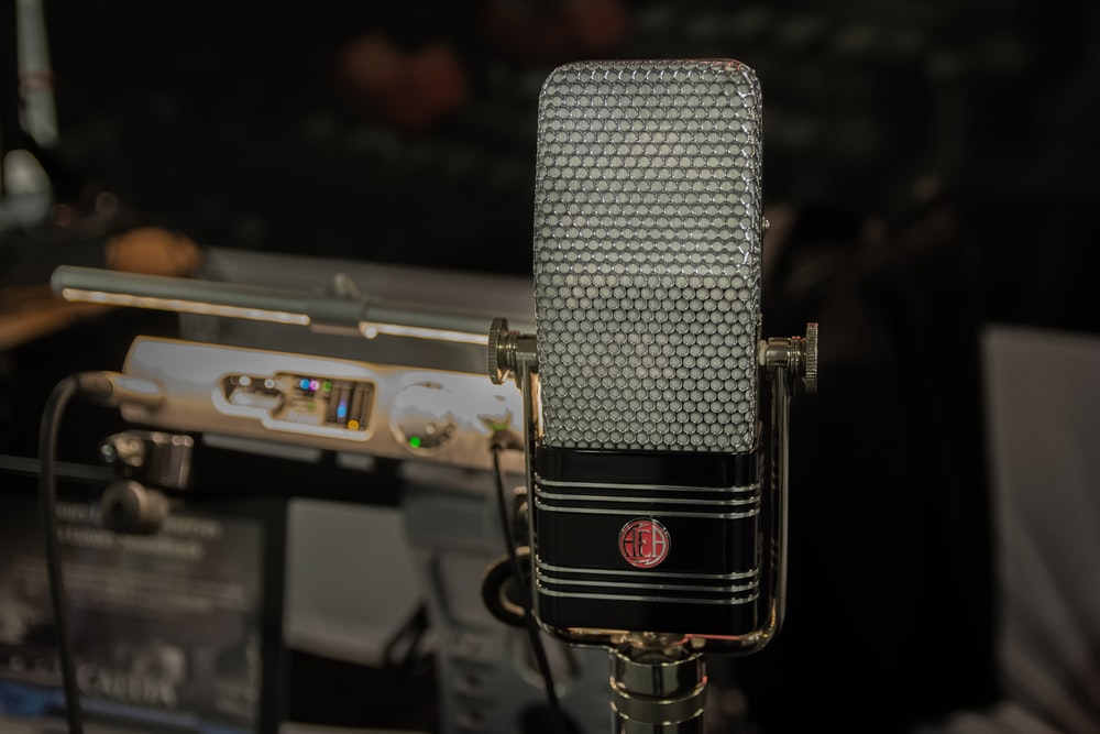 black and silver microphone on black microphone stand