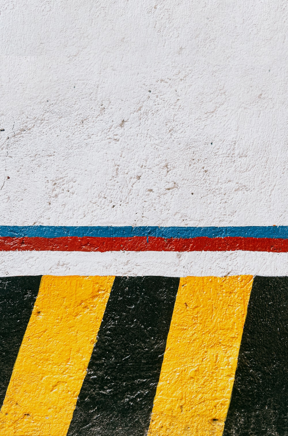 white red yellow and blue painted wall