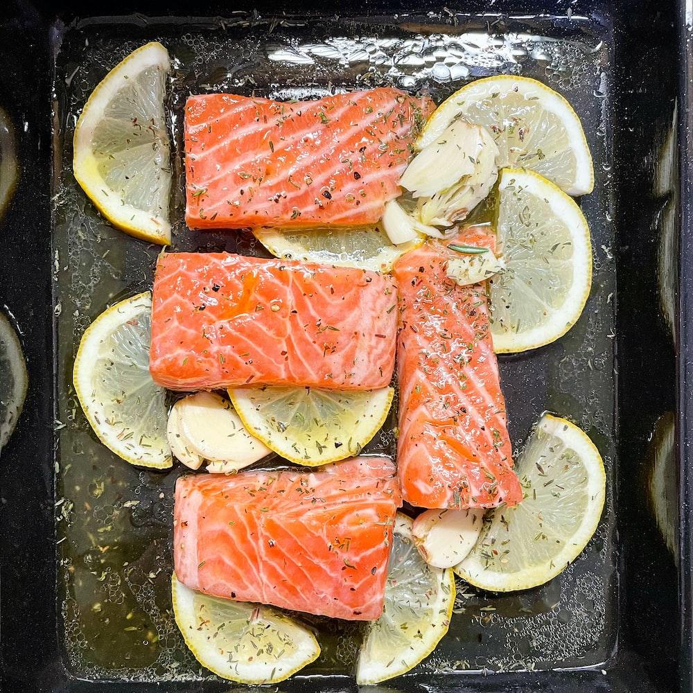 sliced fish meat on black plate