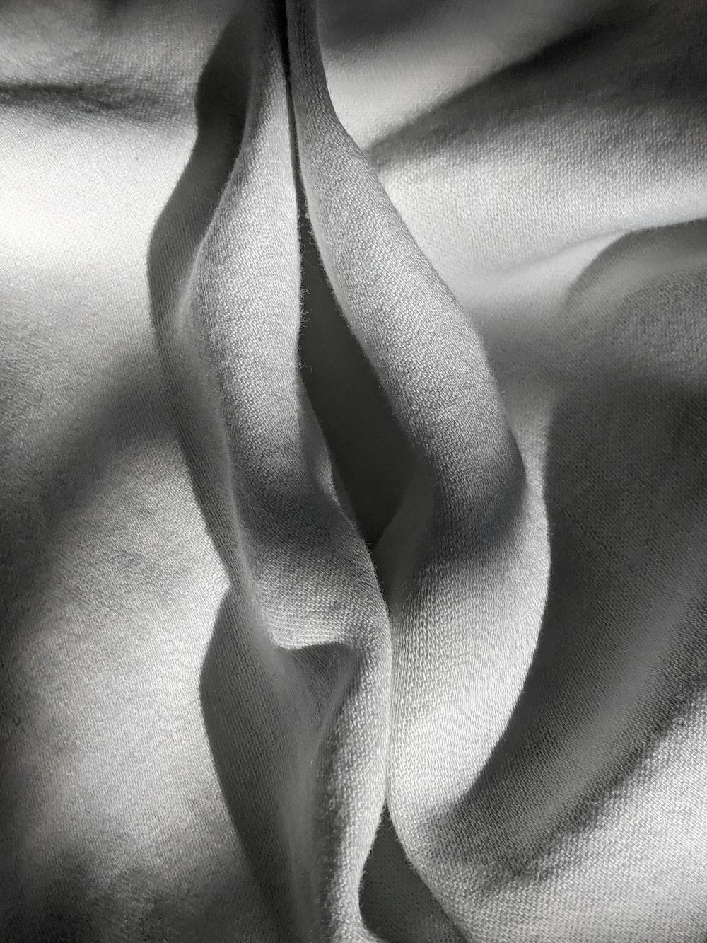 white textile on black textile
