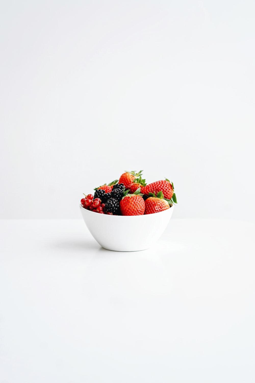 strawberries in white ceramic bowl