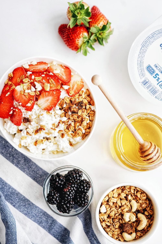strawberry and blackberry on white ceramic bowl