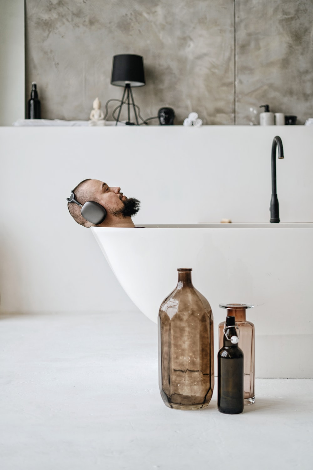 brown glass bottle on white table