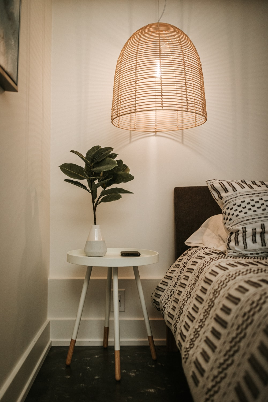 white table lamp on white round table