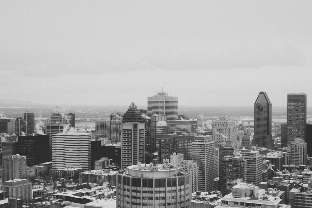 grayscale photo of city buildings during daytime