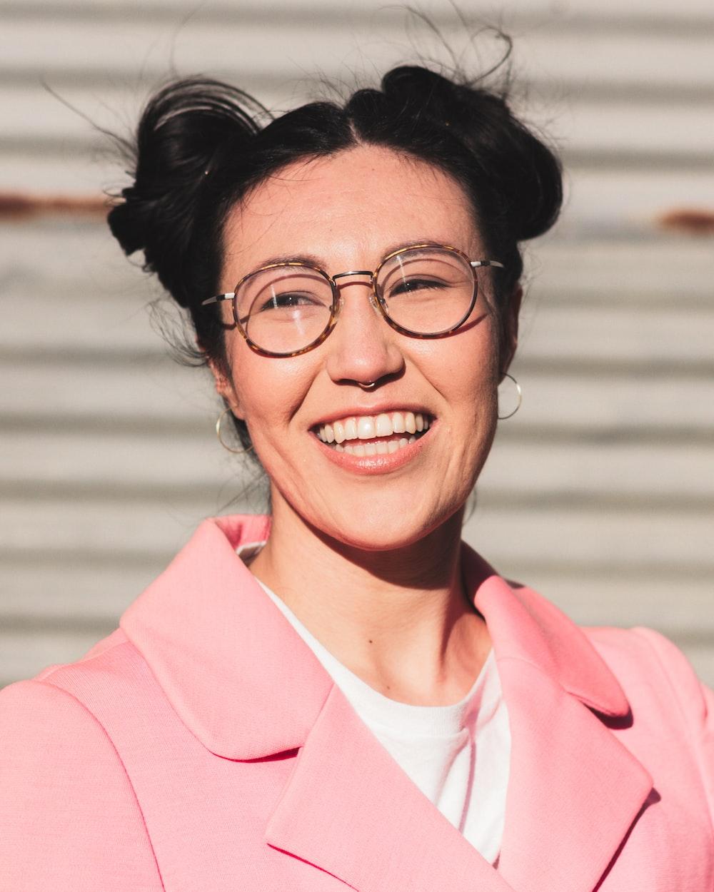 woman in pink blazer smiling