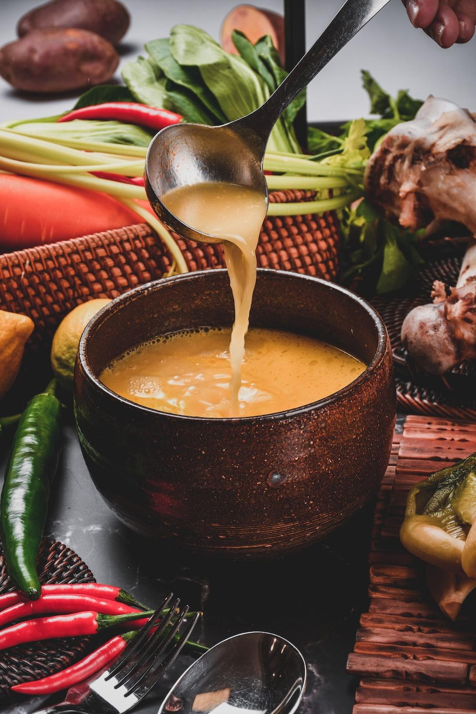 soup in black ceramic bowl
