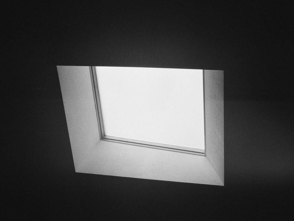 white rectangular frame on black surface