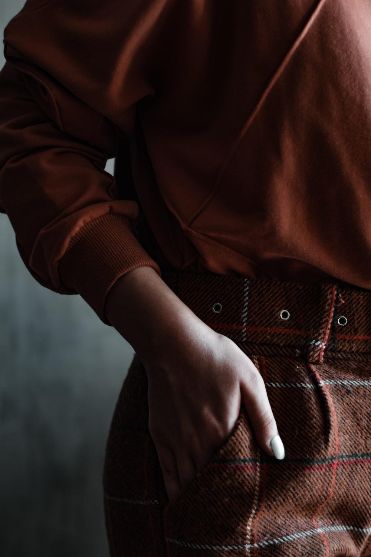 man in brown long sleeve shirt