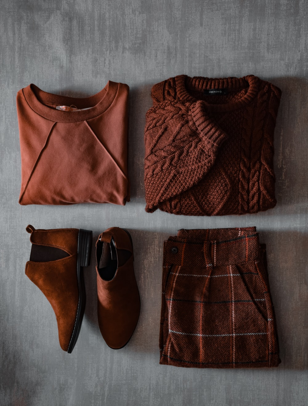 brown leather shoes beside brown leather belt