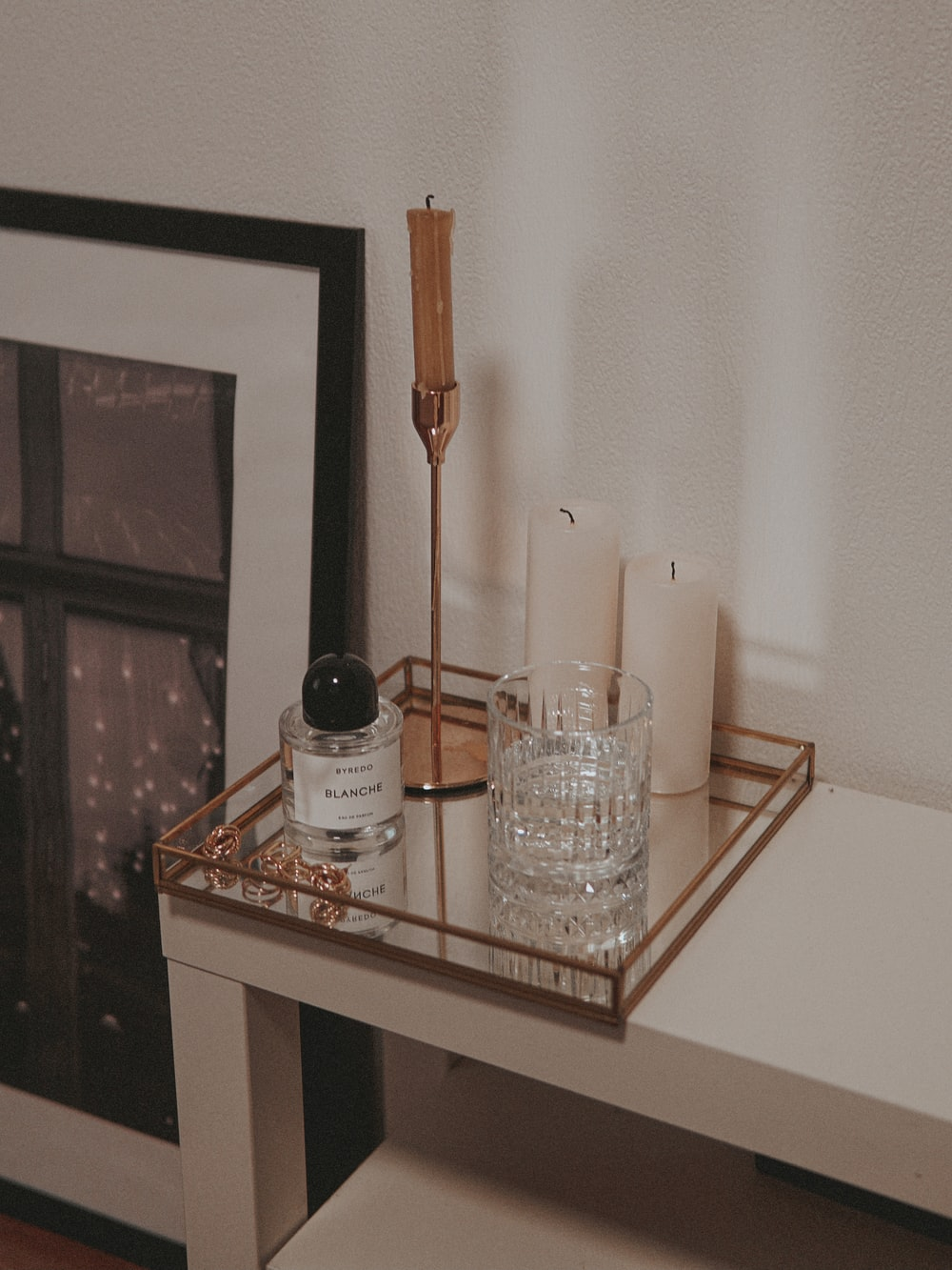 clear drinking glass on white wooden table