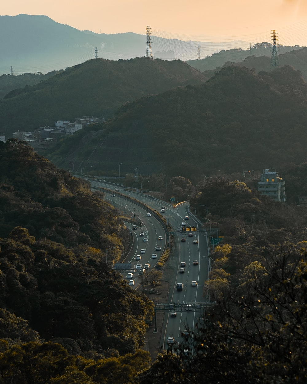 cars on road near mountain during daytime