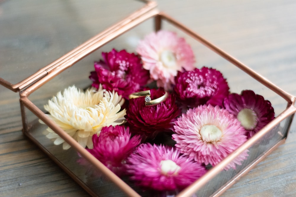 pink and yellow flowers in brown box