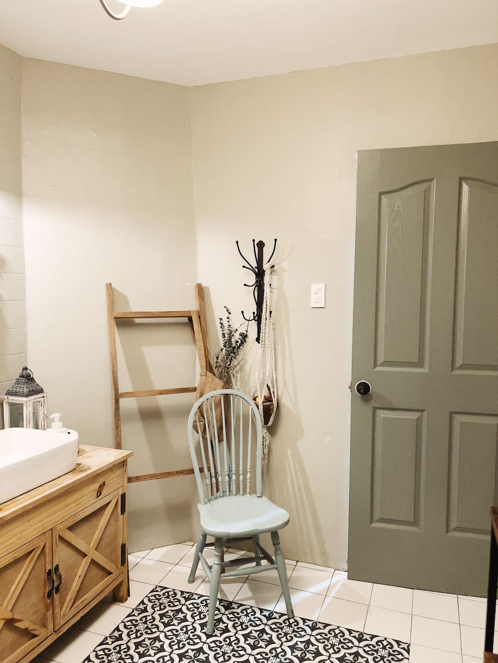 white wooden door beside white ceramic sink