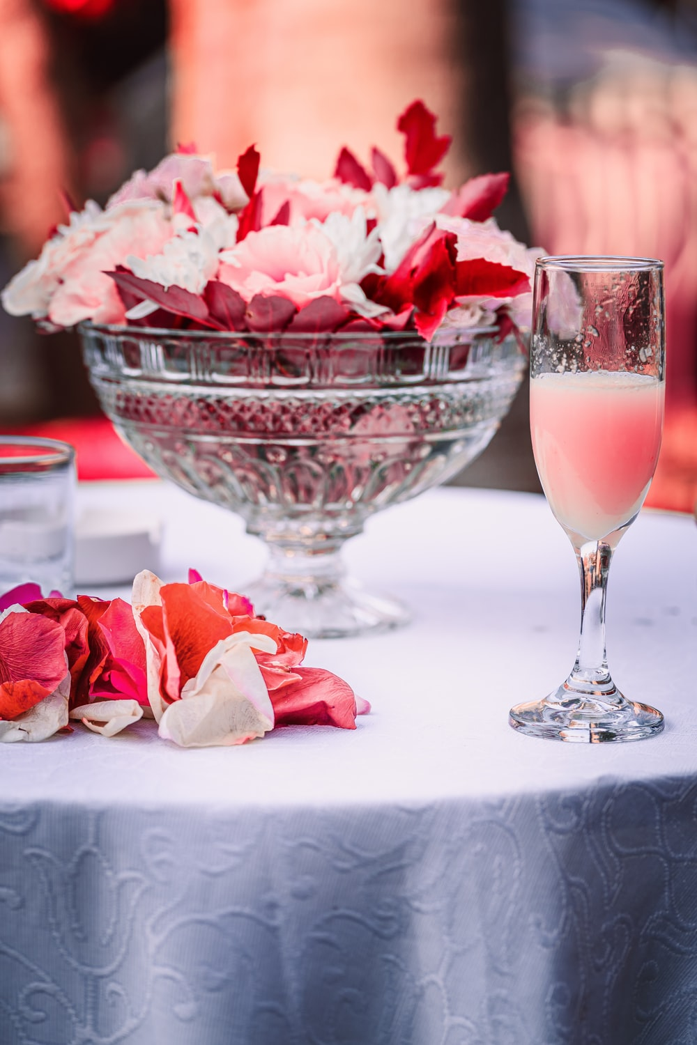 pink rose bouquet in clear glass wine glass