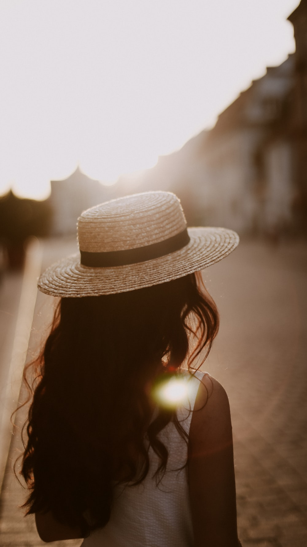 woman wearing brown sun hat during daytime