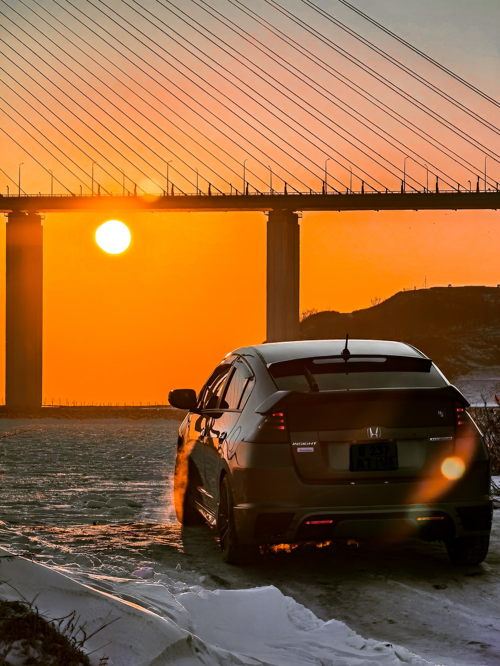 silver bmw m 3 parked on beach shore during sunset