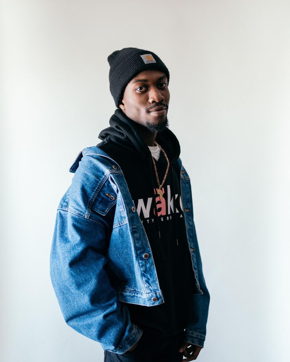 man in blue denim jacket and black knit cap