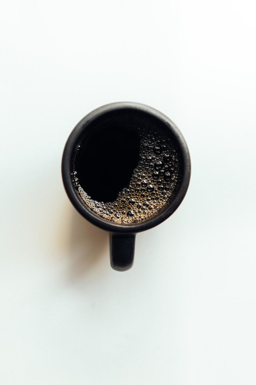 black ceramic mug with black coffee