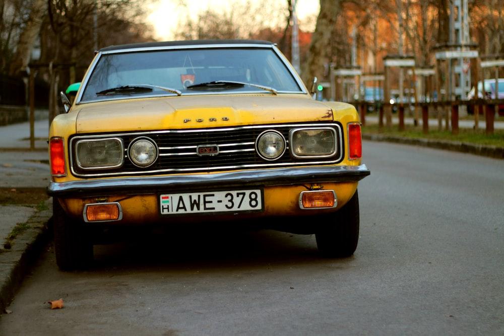 yellow chevrolet camaro on road during daytime