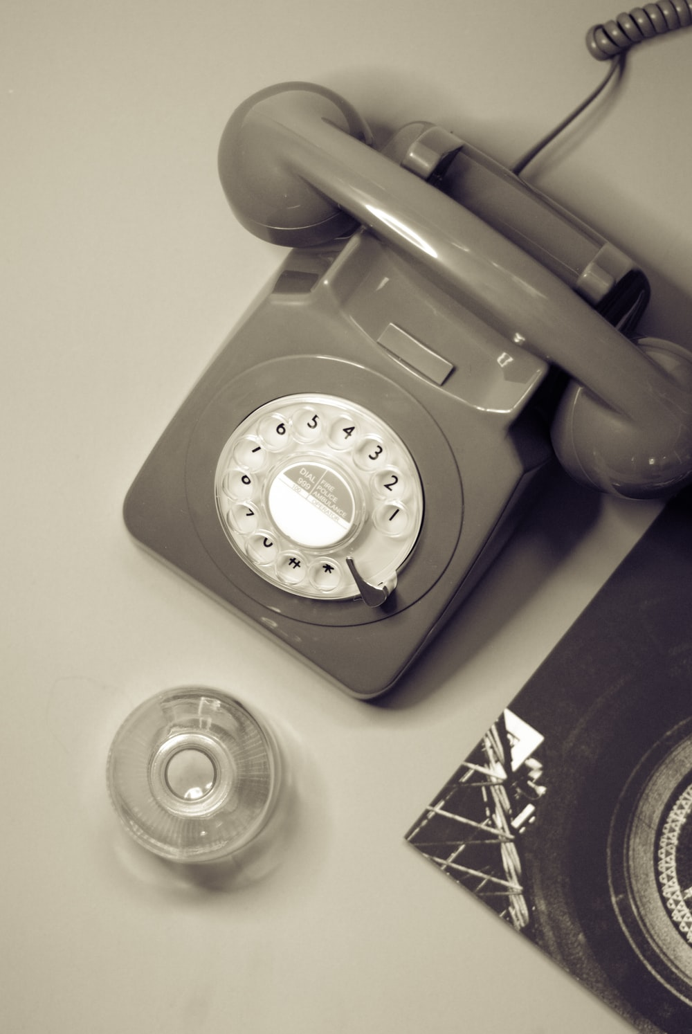 brown rotary phone on white table