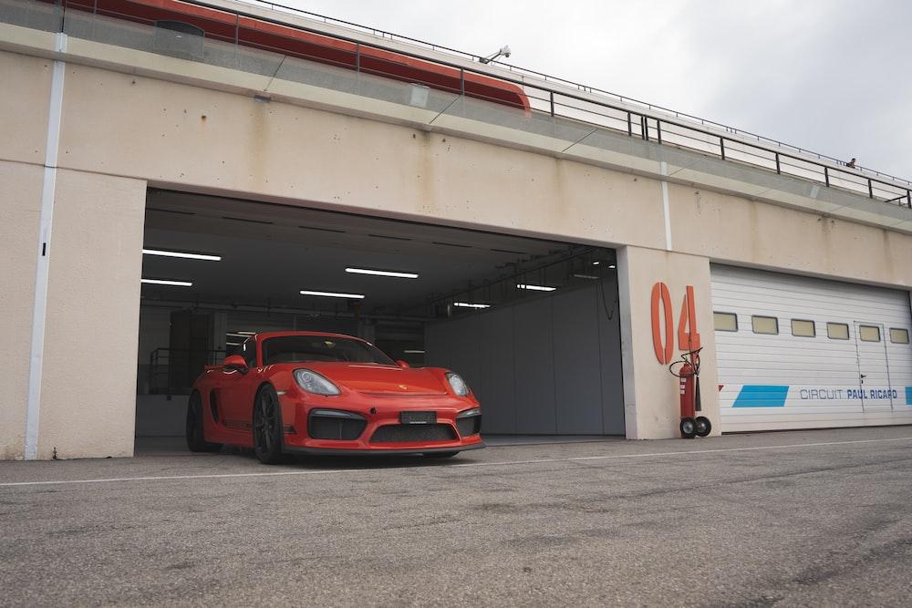 red ferrari 458 italia parked on parking lot