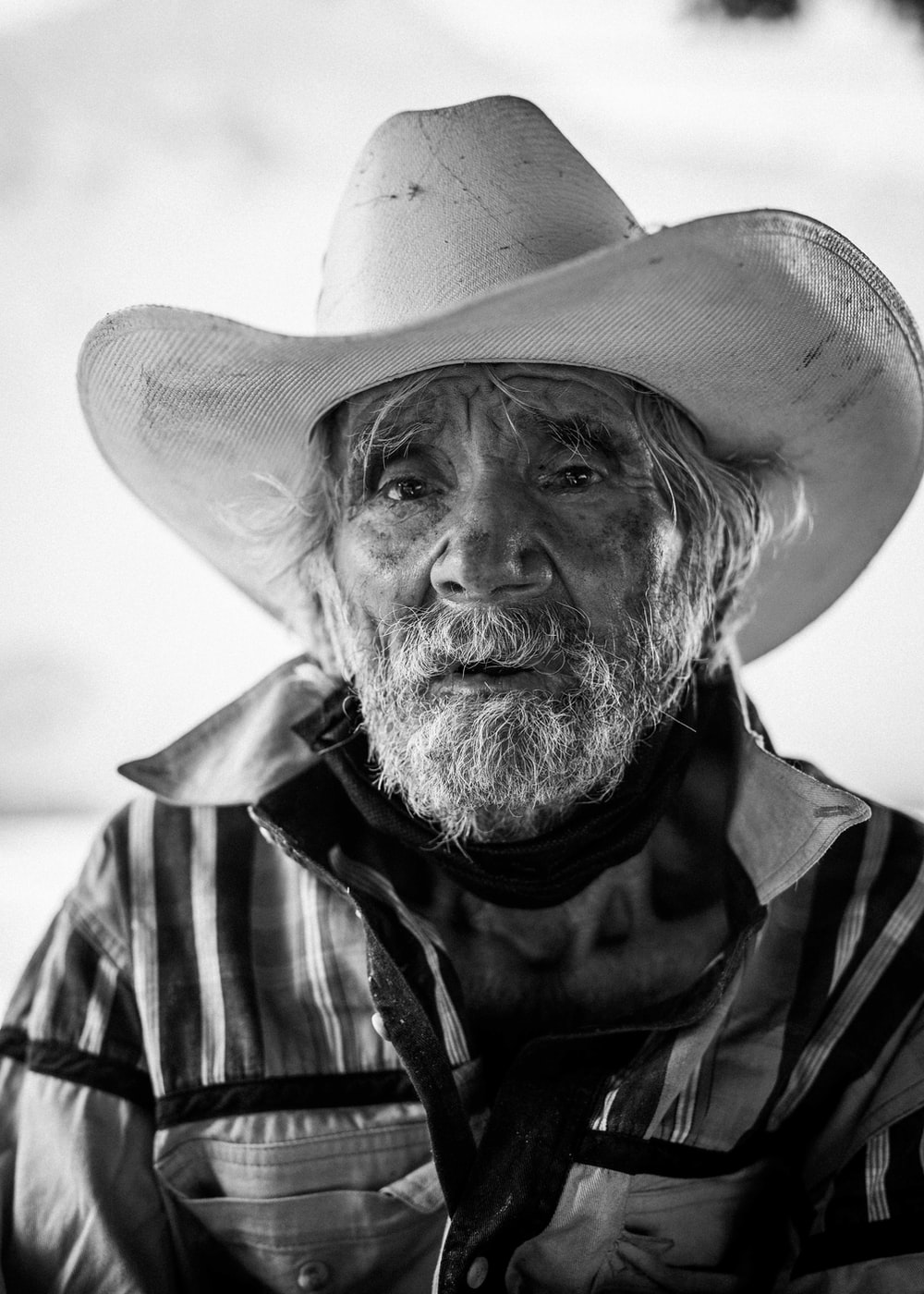 man in cowboy hat in grayscale photography