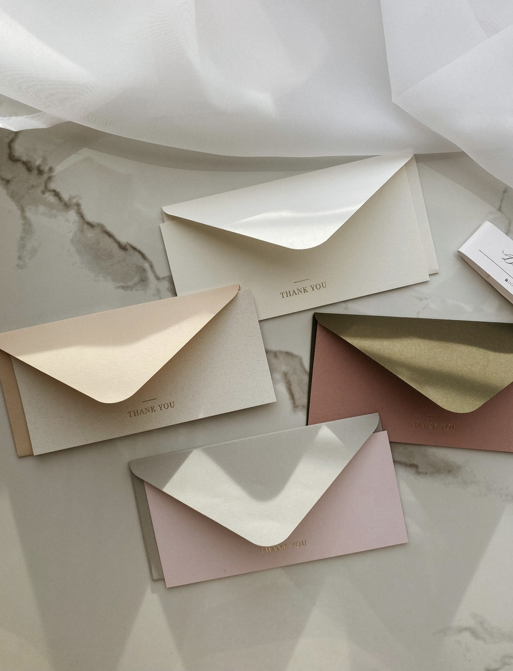 white and brown greeting cards