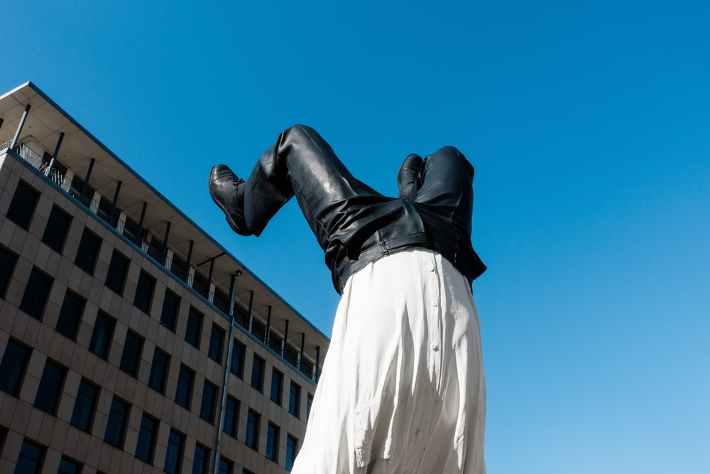 man in white dress shirt and pants statue