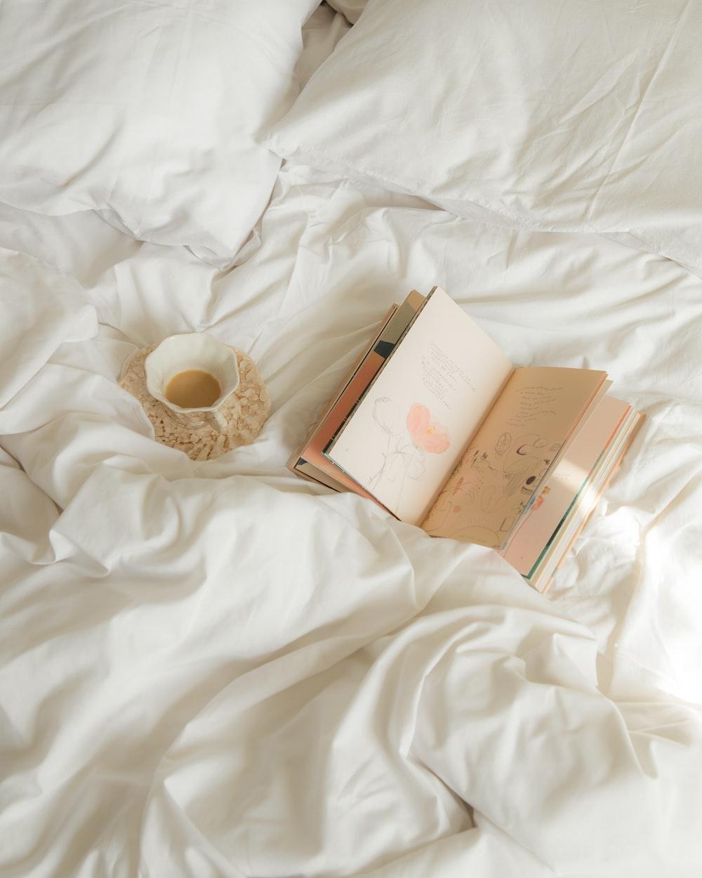 white and gold box on white textile