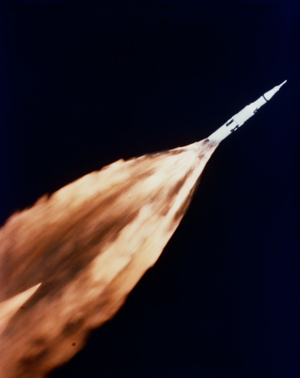 Saturn rocket with a trail of flames during launch