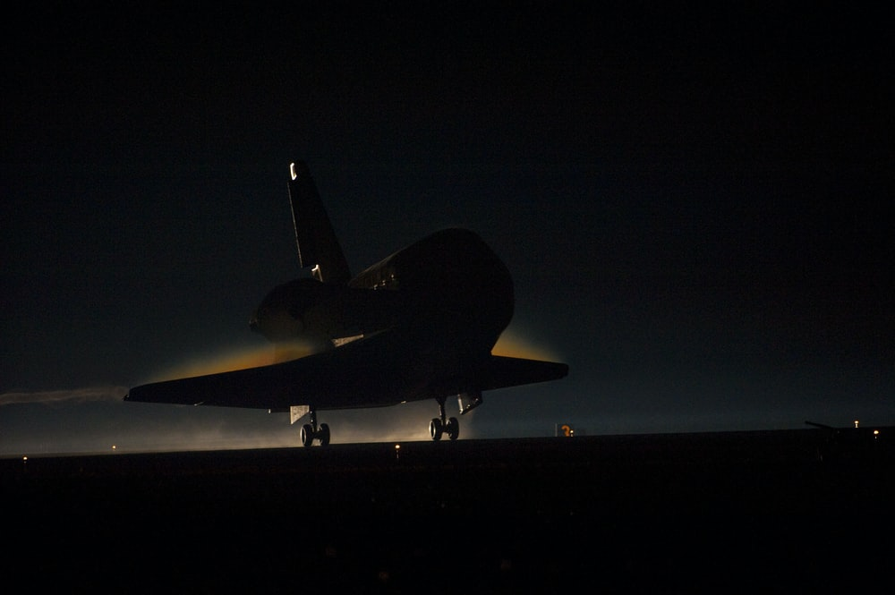 Space Shuttle Atlantis lands in the dark
