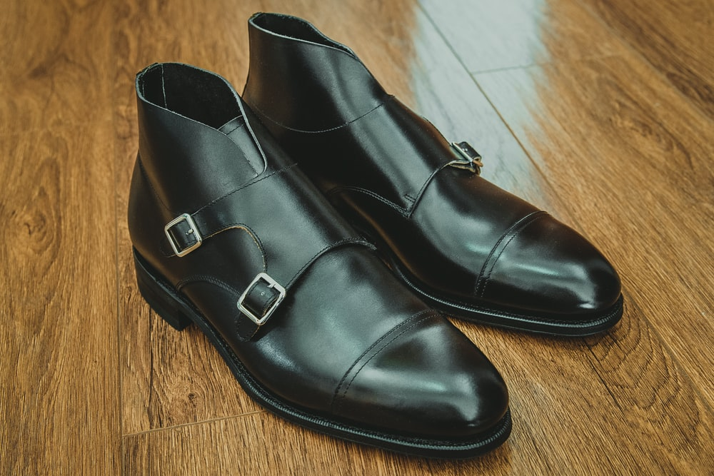 black leather shoes on brown wooden floor