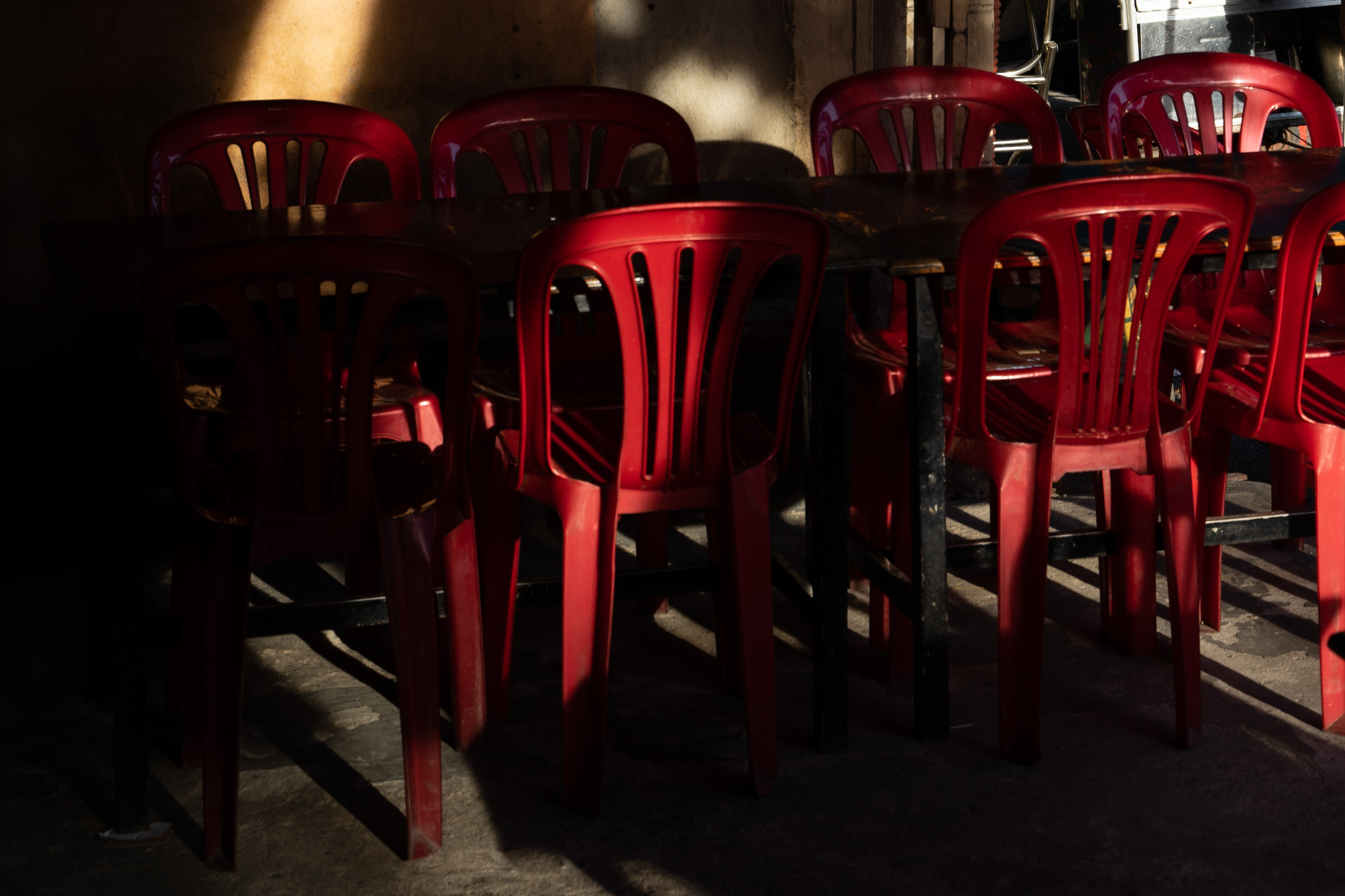 red chairs and tables inside restaurant