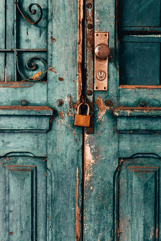 blue wooden door with padlock