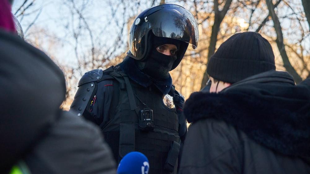 man in black jacket wearing helmet