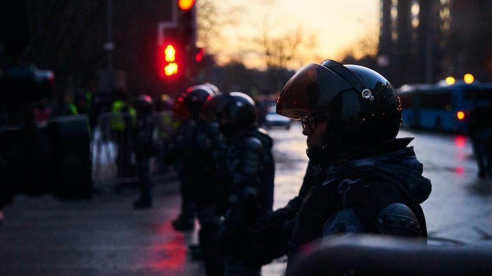people in black jacket and helmet on street during daytime