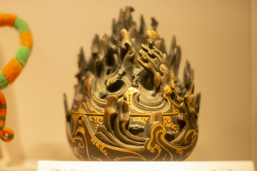 gold and black dragon figurine