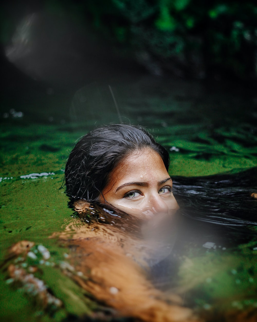 woman in water in close up photography