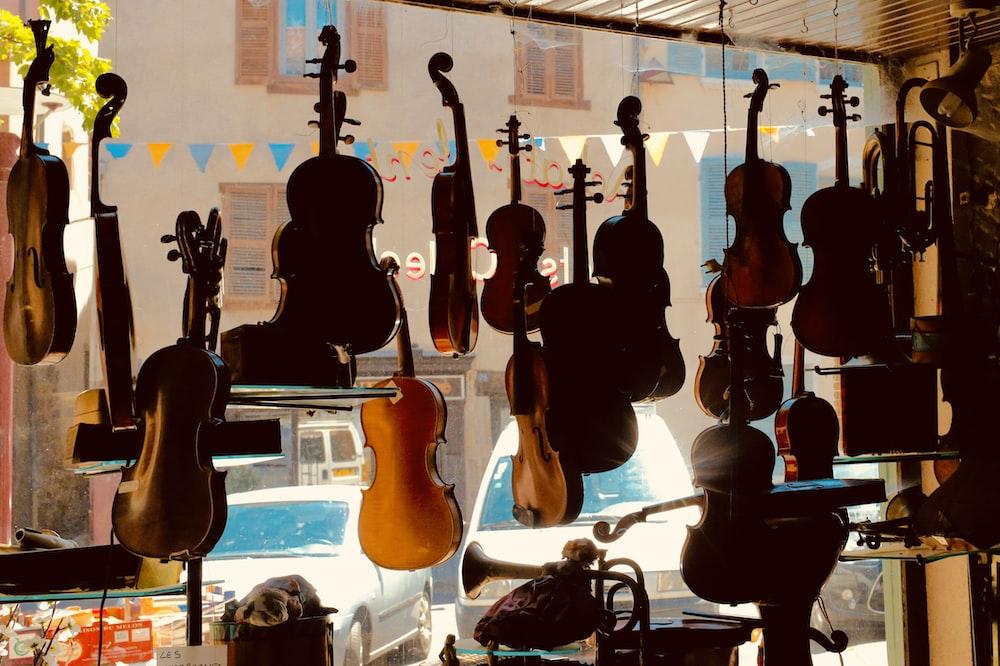 brown and black acoustic guitars