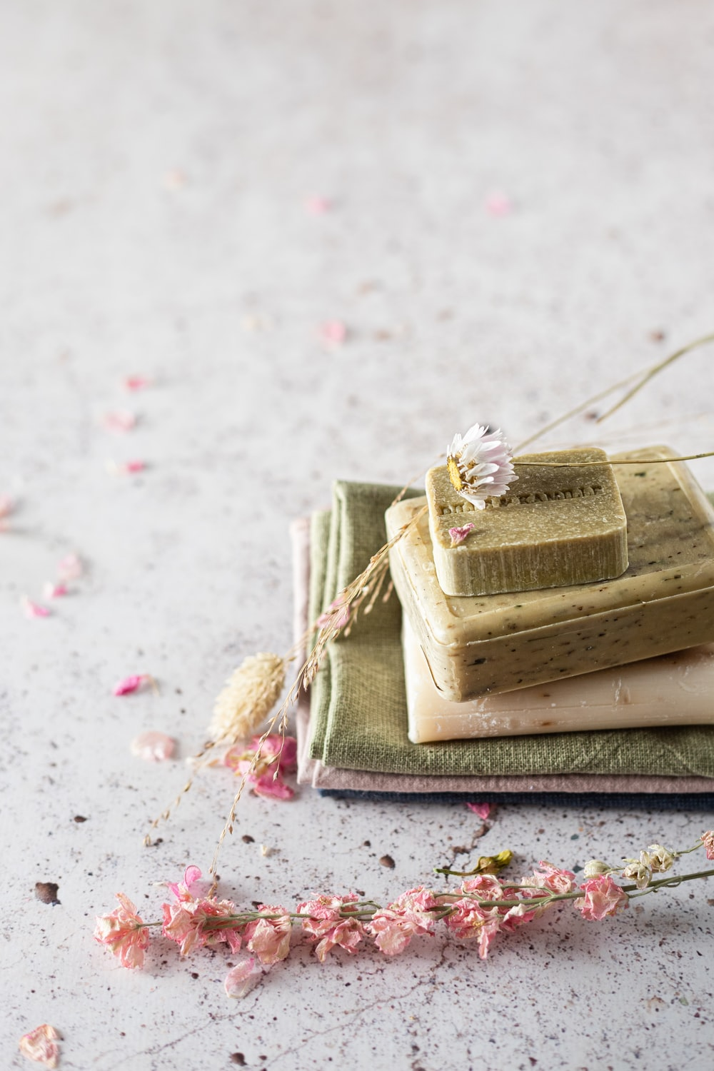 brown and beige cake on white and pink floral textile
