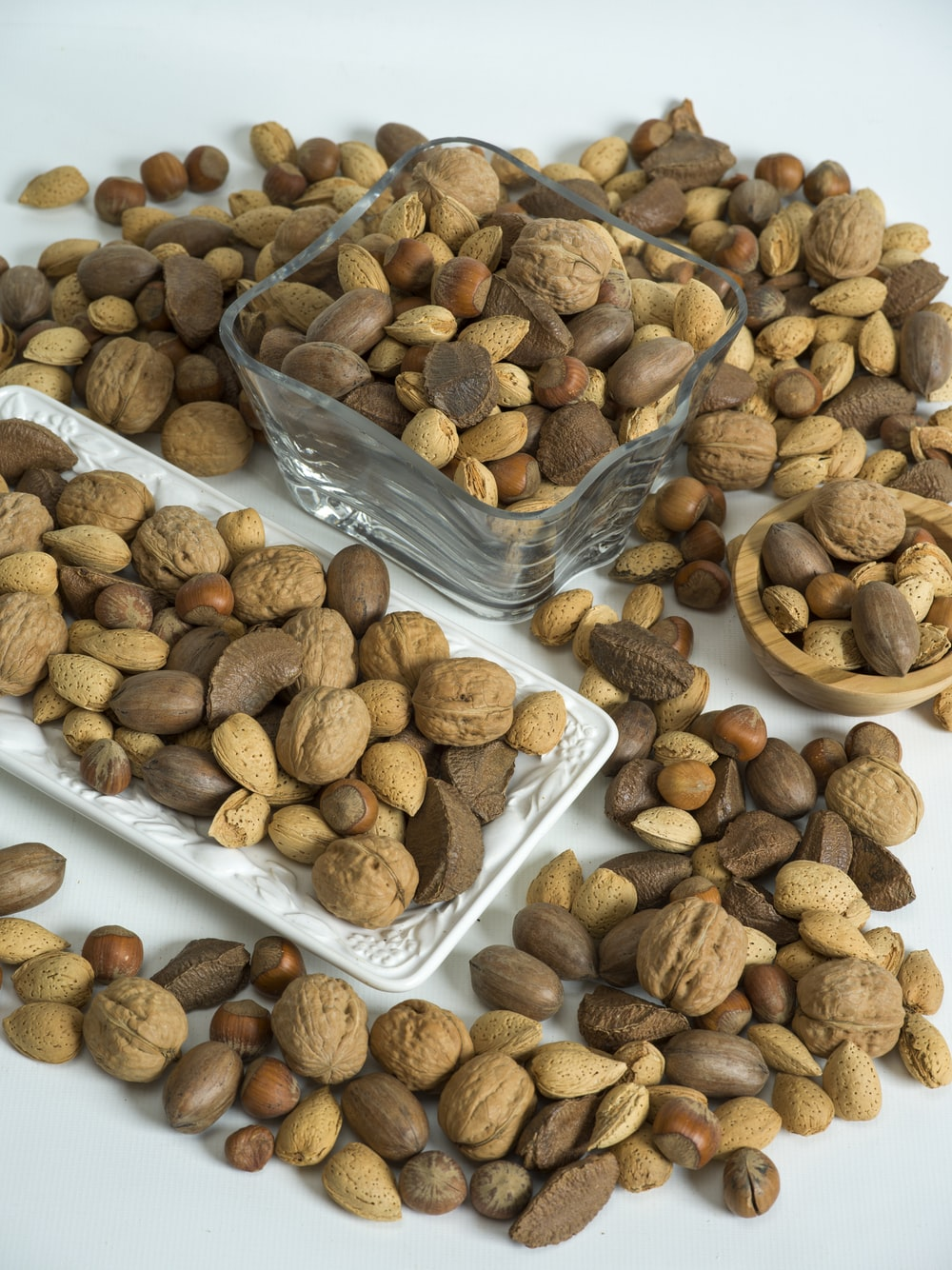 brown almond nuts on white plastic container
