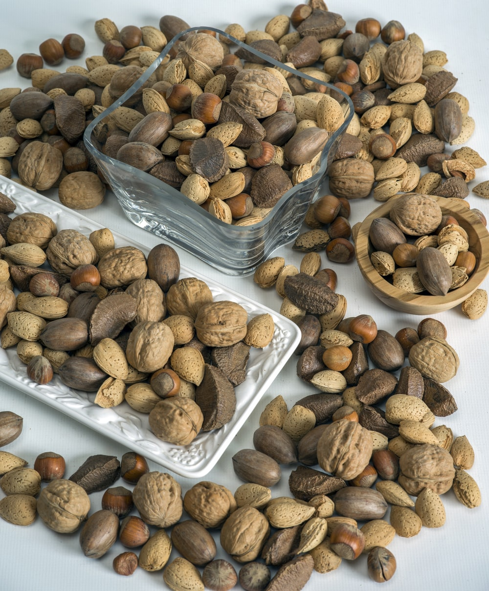 brown and black nuts on clear plastic container
