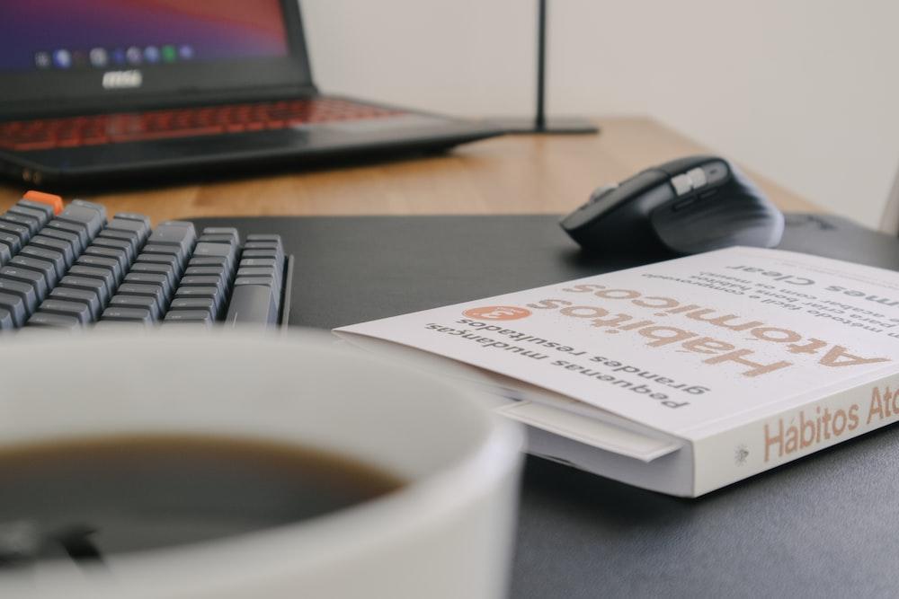 white printer paper beside black computer mouse