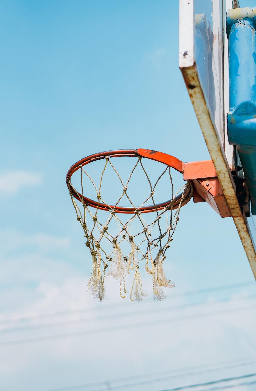 orange basketball hoop under blue sky during daytime