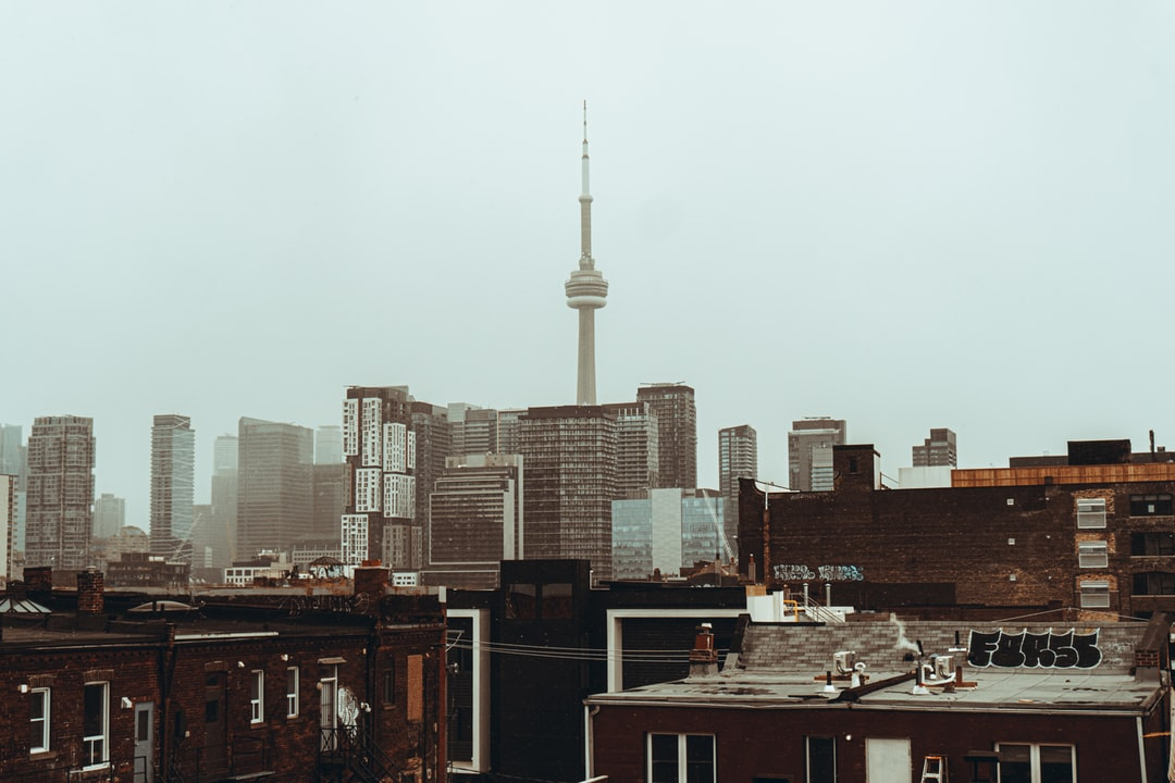 City Skyline Under White Sky During Daytime - unsplash