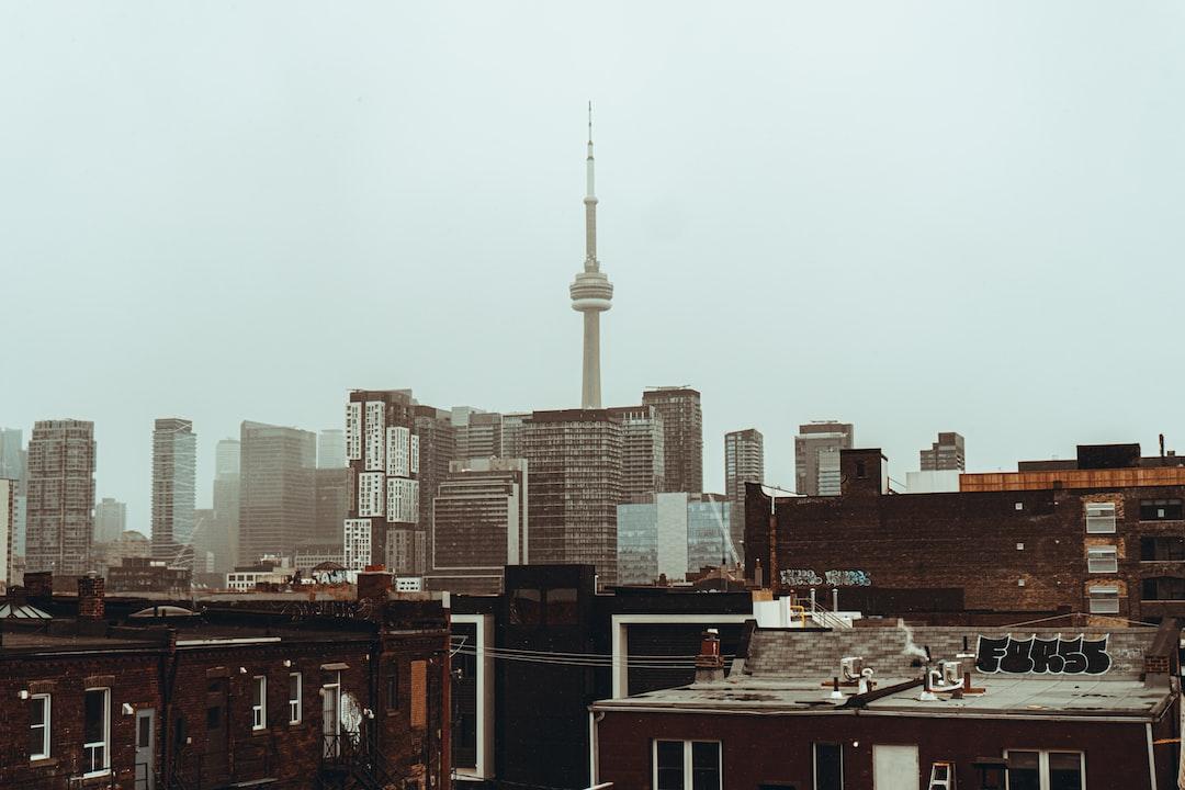City Skyline Under White Sky During Daytime - unsplash
