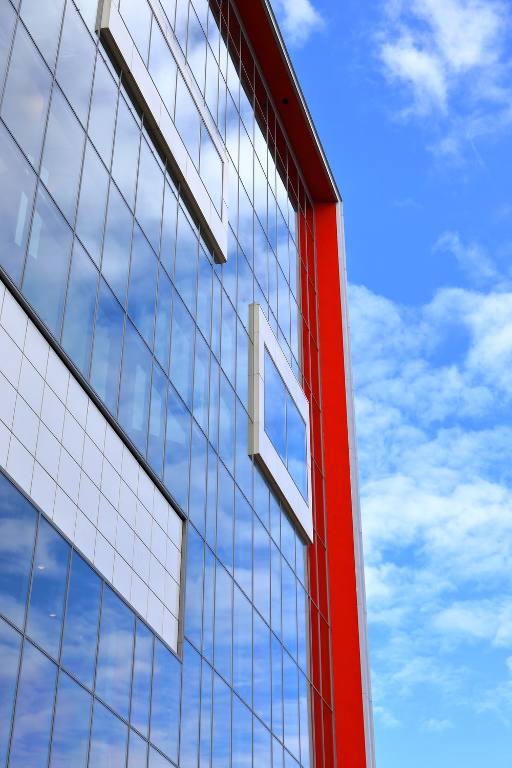 red and white building under blue sky during daytime