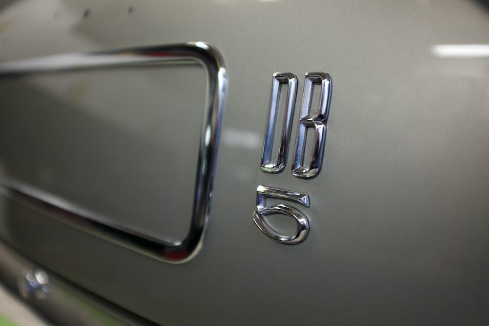silver door handle on white door