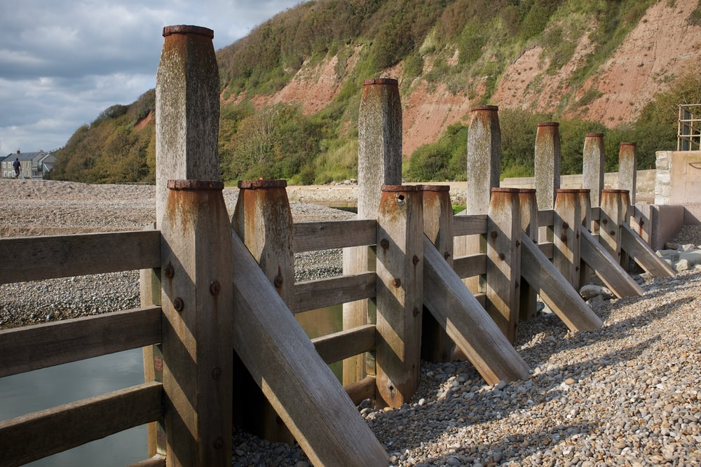 brown wooden fence on hill